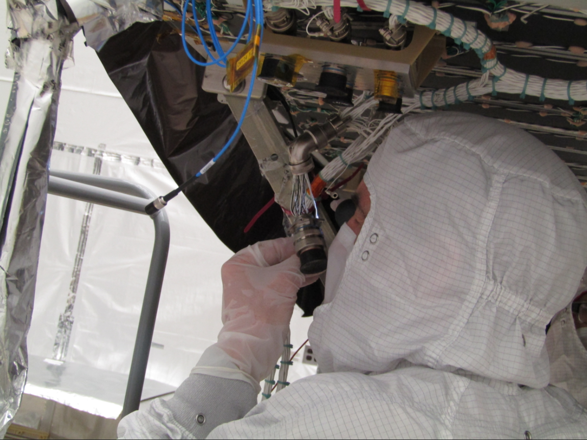A technician works on GOES-T