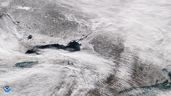 In this NOAA-20 imagery from Jan. 18, 2016 (left) and Jan. 19, 2016 (right), you can see lake effect snow bands moving off the southern edge of Lake Ontario and blowing eastward into New York.