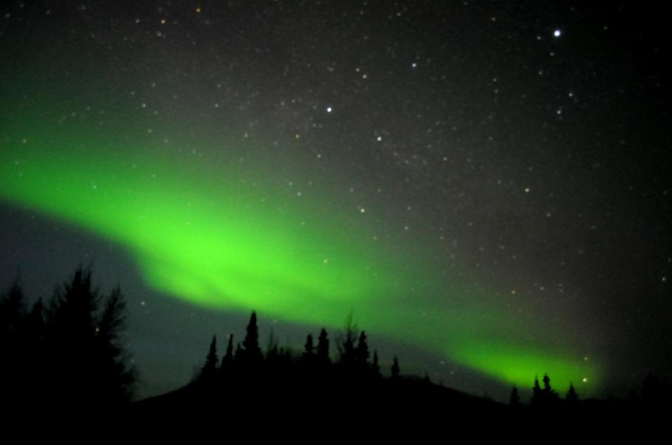 An aurora as seen over the Poker Flat Research Range north of Fairbanks, Alaska, on Feb. 28, 2011. Credit NOAA.